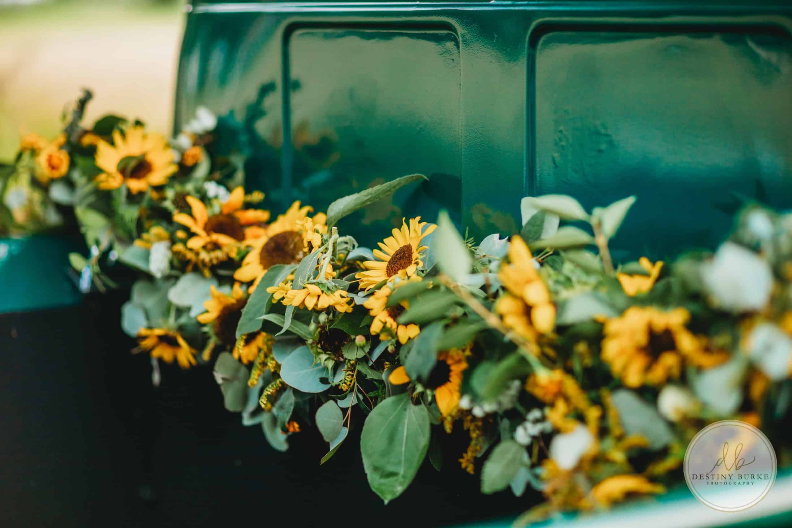 Truck, Florals, flowers, couple, photo session, anniversary session, sunflowers, dress, studabaker, vintage truck, vintage, sungrove blossoms
