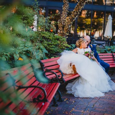 Max of Eastman Place, Rochester, NY, Wedding, Photography, Photographer, Trees, dress, blue tux, benches, brick walkway, mirrored glass, downtown rochester, ROC, bride, groom, marriage